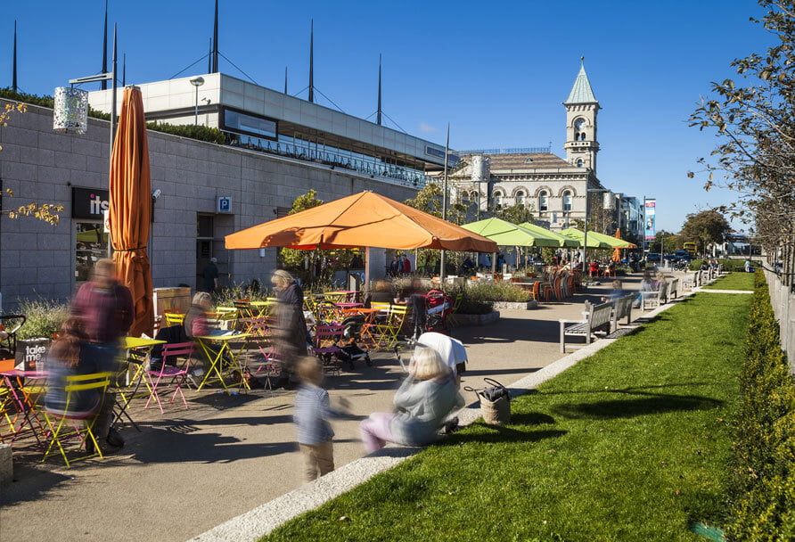 Photo of an open-air food court & park, near St. Paul's Square.